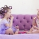 Little Girls in Hair Curlers Paint Lips on a Bed. - VideoHive Item for Sale