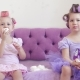 Two Little Girls in Curlers Eat Marshmallows and Treat Each Other. - VideoHive Item for Sale