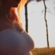Beautiful Pregnant Girl at Sunset Stroking the Belly - VideoHive Item for Sale