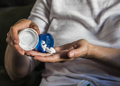 Woman with overweight takes medication, conceptual image - PhotoDune Item for Sale