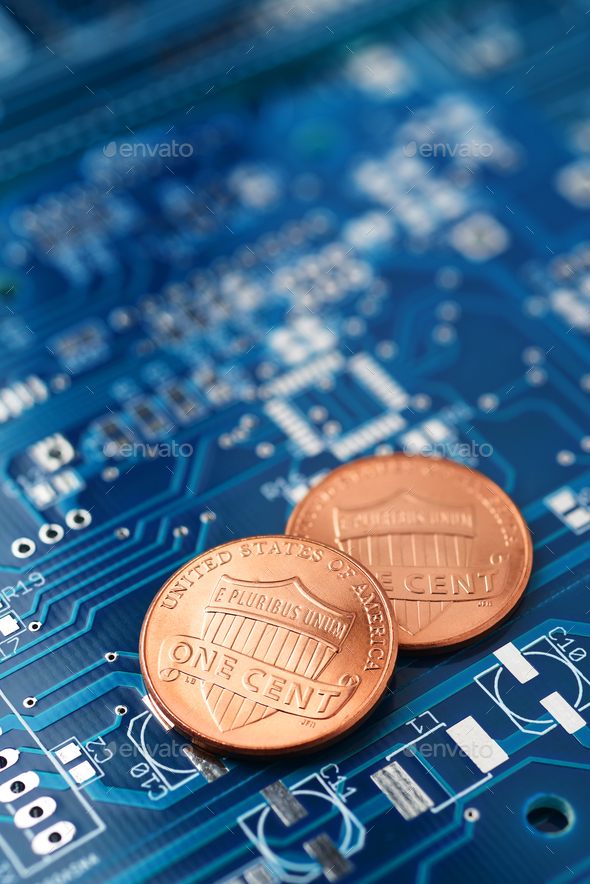 Coins and printed circuit board - Stock Photo - Images