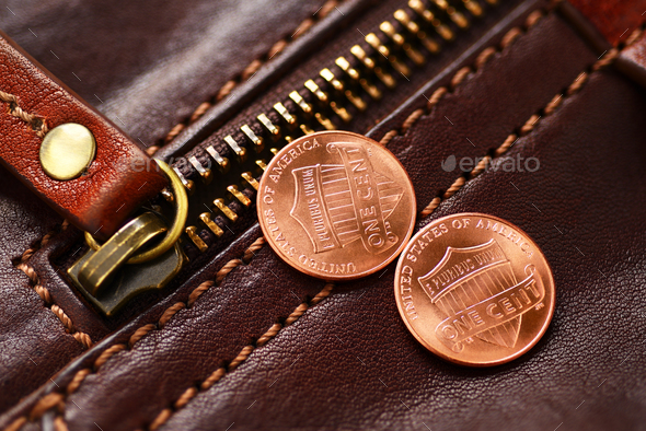 Zipper fastener and penny - Stock Photo - Images