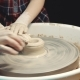 Master Class in Pottery. the Teacher Learn the Child To Form Clay on a Potter's Wheel
