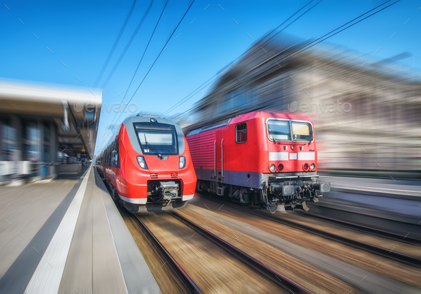 High speed train and old train in motion on the railway station - Stock Photo - Images