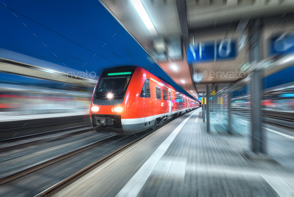 High speed train in motion on the railway station at night - Stock Photo - Images