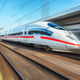White modern high speed train in motion on railway station - PhotoDune Item for Sale