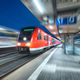 High speed train in motion on the railway station at night - PhotoDune Item for Sale