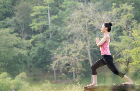 young beautiful asian woman practicing yoga - Stock Photo - Images