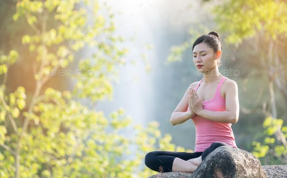 young beautiful asian woman practicing yoga - Stock Photo - Images