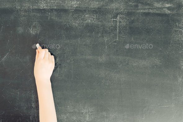 child's hand with chalk on black chalkboard - Stock Photo - Images