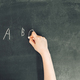 child's hand with chalk write alphabet on black chalkboard - PhotoDune Item for Sale