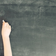 child's hand with chalk on black chalkboard - PhotoDune Item for Sale