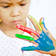 Asian child painting her hand