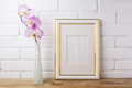 Gold decorated frame mockup with tender pink orchid - PhotoDune Item for Sale