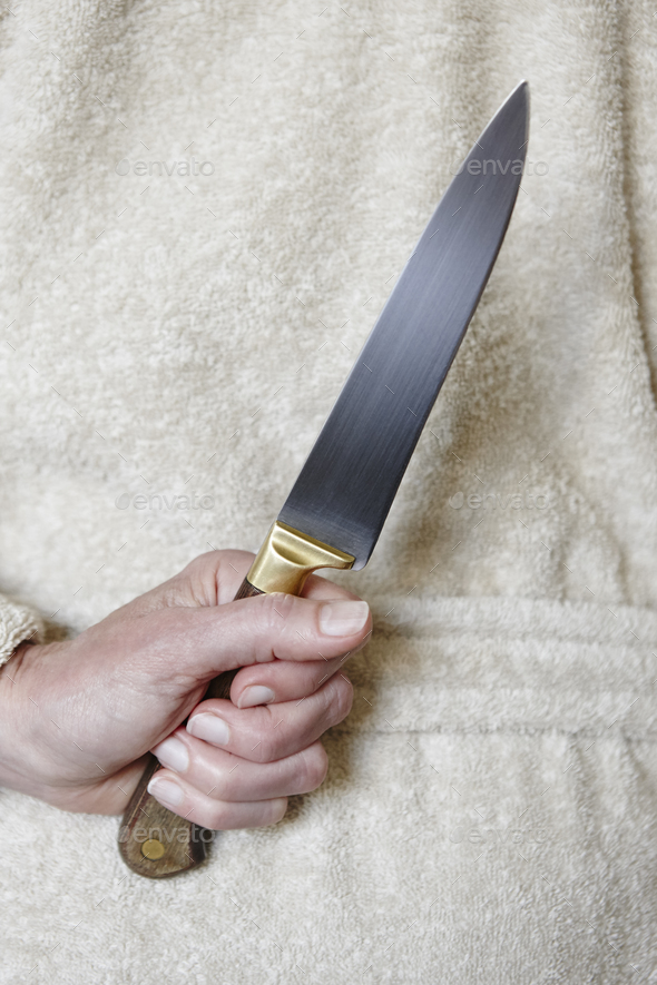 Killer woman with a knife. Violence aggression. Criminal murderer. Assassin - Stock Photo - Images