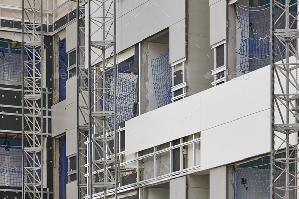 Building facade under construction. Insulation material and tiles. Horizontal - Stock Photo - Images
