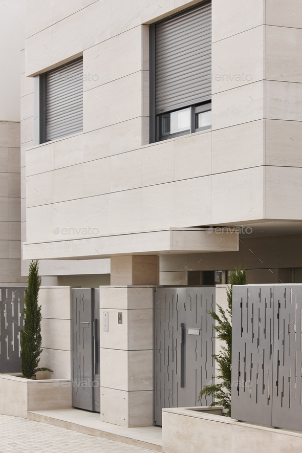 Modern residential building entrance. Estate property. Marble stone. Construction. Vertical - Stock Photo - Images