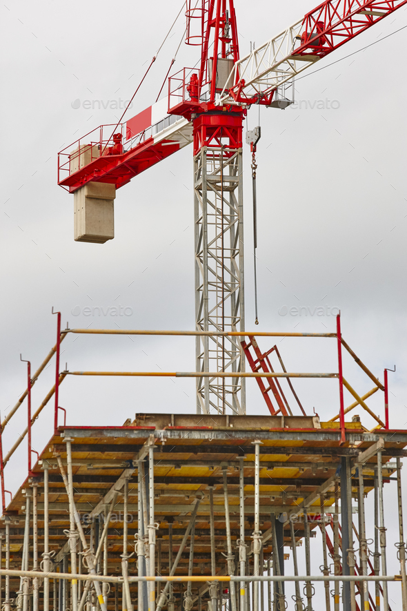 Building under construction. Crane machinery structure. Industry. Vertical - Stock Photo - Images