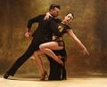 Dance ballroom couple in gold dress dancing on studio background. - PhotoDune Item for Sale