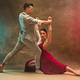 Flexible young modern dance couple posing in studio. - PhotoDune Item for Sale
