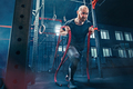 Men with battle rope battle ropes exercise in the fitness gym. CrossFit. - PhotoDune Item for Sale