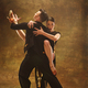 Dance ballroom couple in gold dress dancing on studio background. - PhotoDune Item for Sale