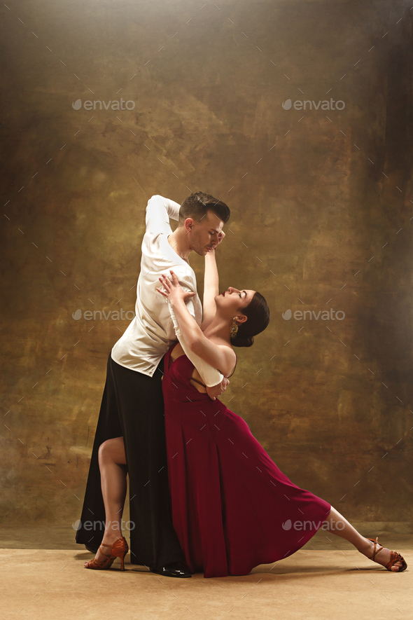Dance ballroom couple in red dress dancing on studio background. - Stock Photo - Images