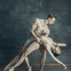 The young modern ballet dancers posing on gray studio background - PhotoDune Item for Sale