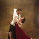 Dance ballroom couple in red dress dancing on studio background. - PhotoDune Item for Sale