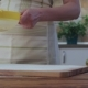 Young Woman Sifting Flour Through a Sieve on Wooden Table - VideoHive Item for Sale