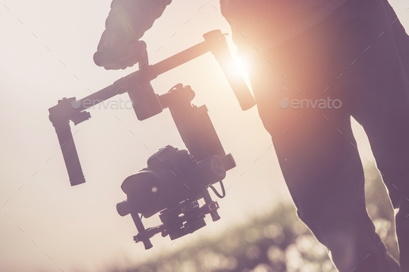 Videographer with Gimbal - Stock Photo - Images