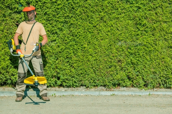 Gas String Trimmers Work - Stock Photo - Images