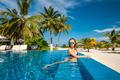 Woman at beach pool in Maldives - PhotoDune Item for Sale