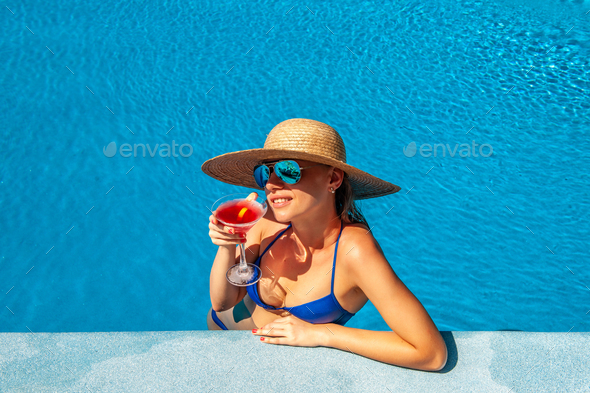 Woman at poolside with cosmopolitan cocktail - Stock Photo - Images