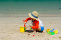Two year old toddler playing on beach - PhotoDune Item for Sale