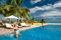 Woman with hat at beach pool in Maldives - PhotoDune Item for Sale
