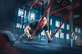 Men with battle rope battle ropes exercise in the fitness gym. - PhotoDune Item for Sale