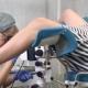 Woman Gynecologist Examining Female Patient Using Colposcope