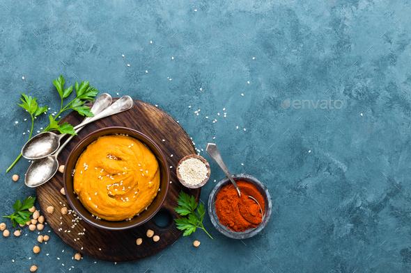 Hummus. Fresh homemade hummus with paprika - Stock Photo - Images