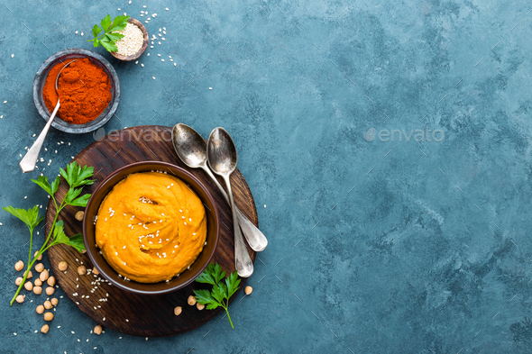 Hummus. Fresh homemade hummus with paprika - Stock Photo - Images