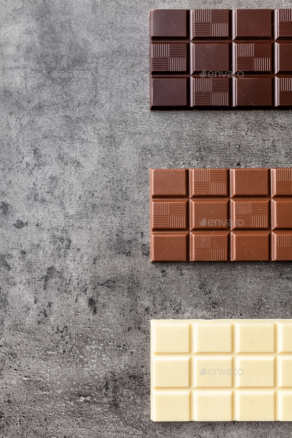 Delicious variety of chocole on rustic background - Stock Photo - Images