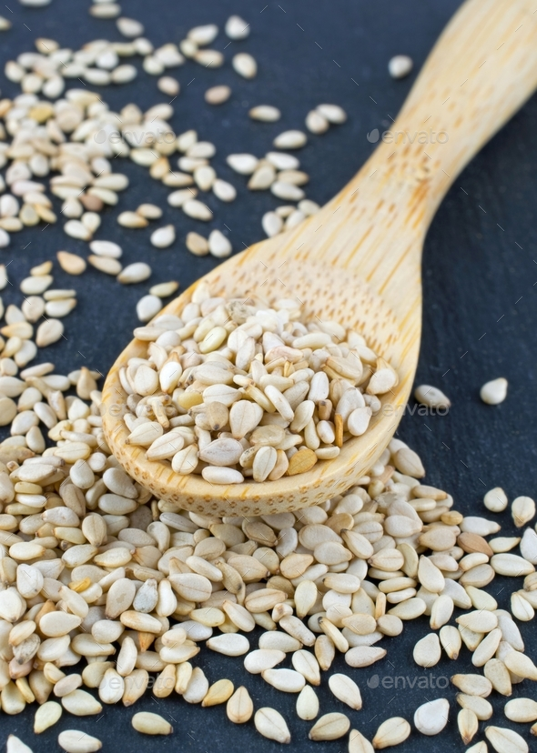 Sesame seeds on a Wooden Spoon - Stock Photo - Images