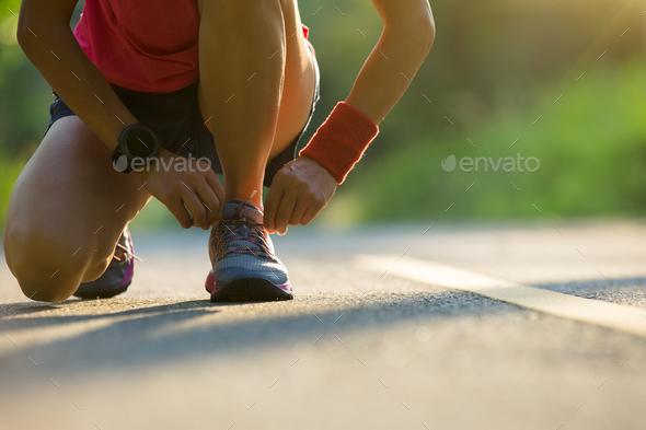 Runner tying shoelace - Stock Photo - Images