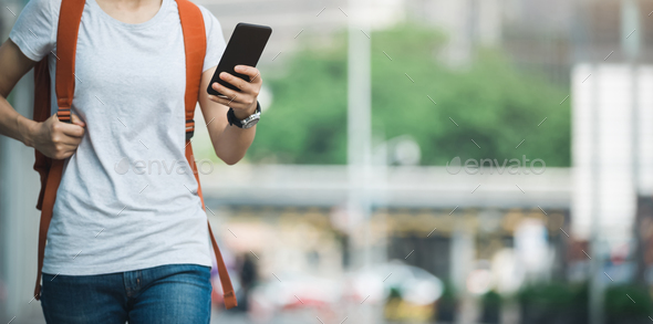 Woman use mobile phone on street - Stock Photo - Images