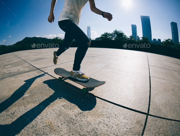 skateboarder skateboarding at sunrise city - Stock Photo - Images