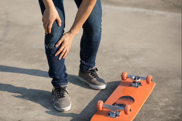 Skateboarding and get injury on knee while fell off - Stock Photo - Images