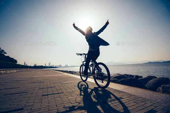 Riding bike on seaside  - Stock Photo - Images