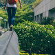 Young woman walking on the edge of a urban building wall at city - PhotoDune Item for Sale