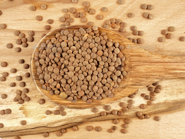 Lentils in wooden spoon - Stock Photo - Images