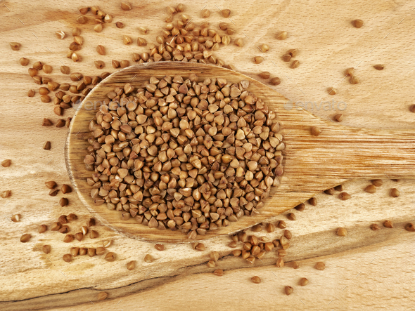 Buckwheat in wooden spoon - Stock Photo - Images